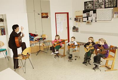 Jeki-Gitarrenunterricht